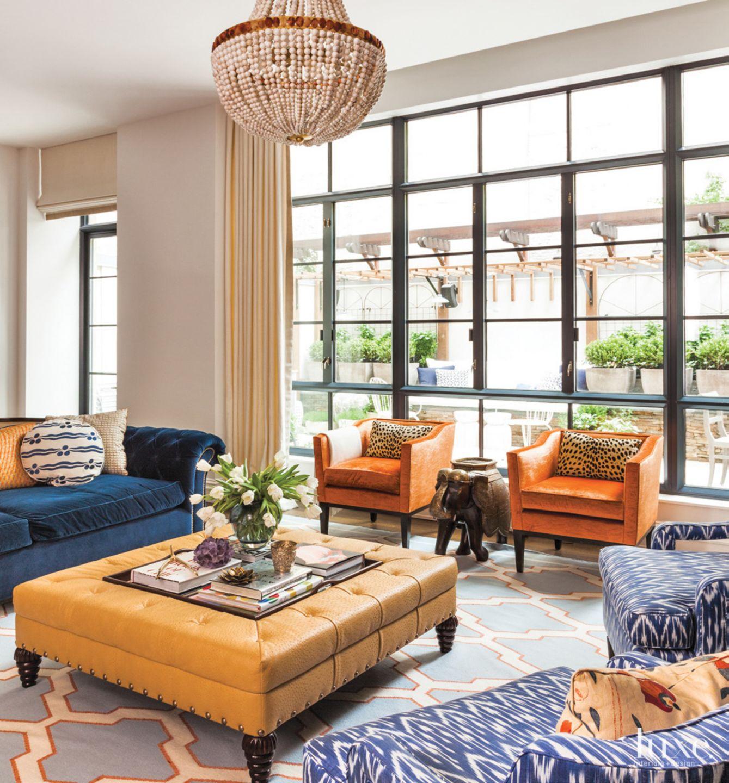 Eclectic White Living Room with Orange Velvet Armchairs