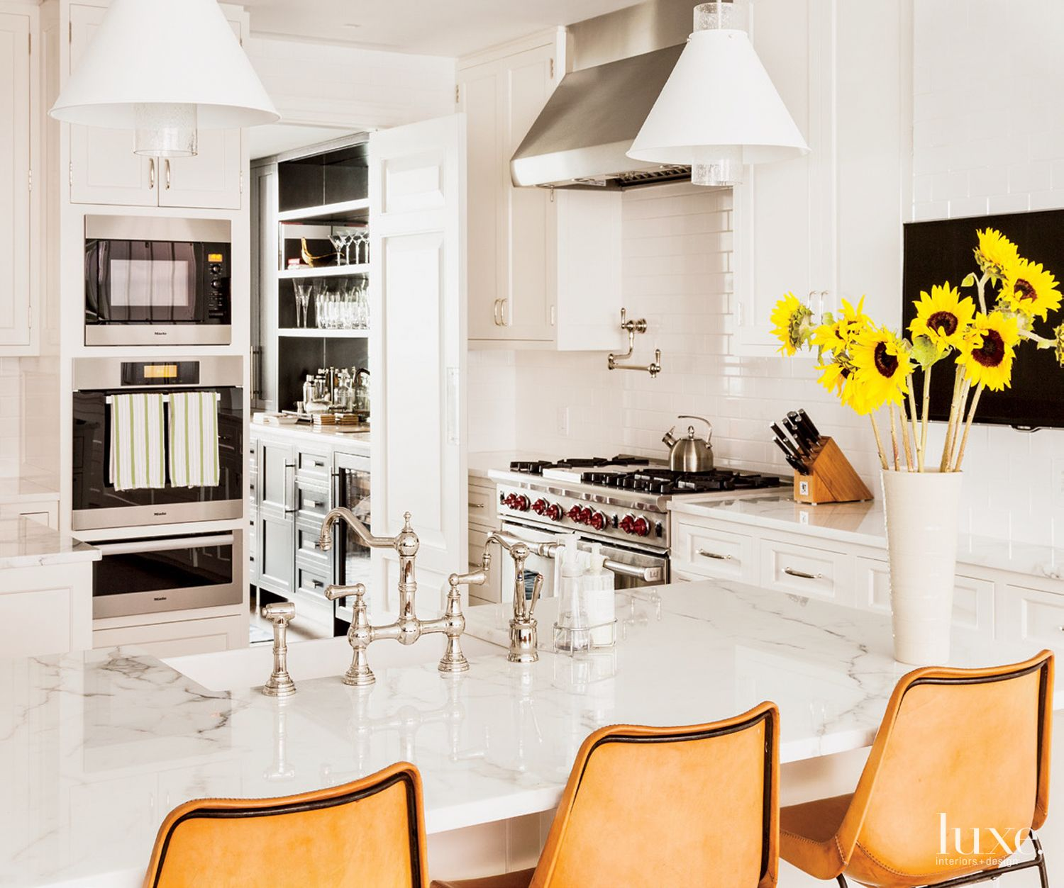 Contemporary White Kitchen with Leather Barstools