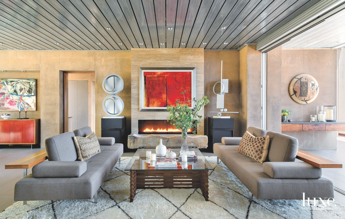 Living Room Connected to the Outside with Sculptures and Fireplace