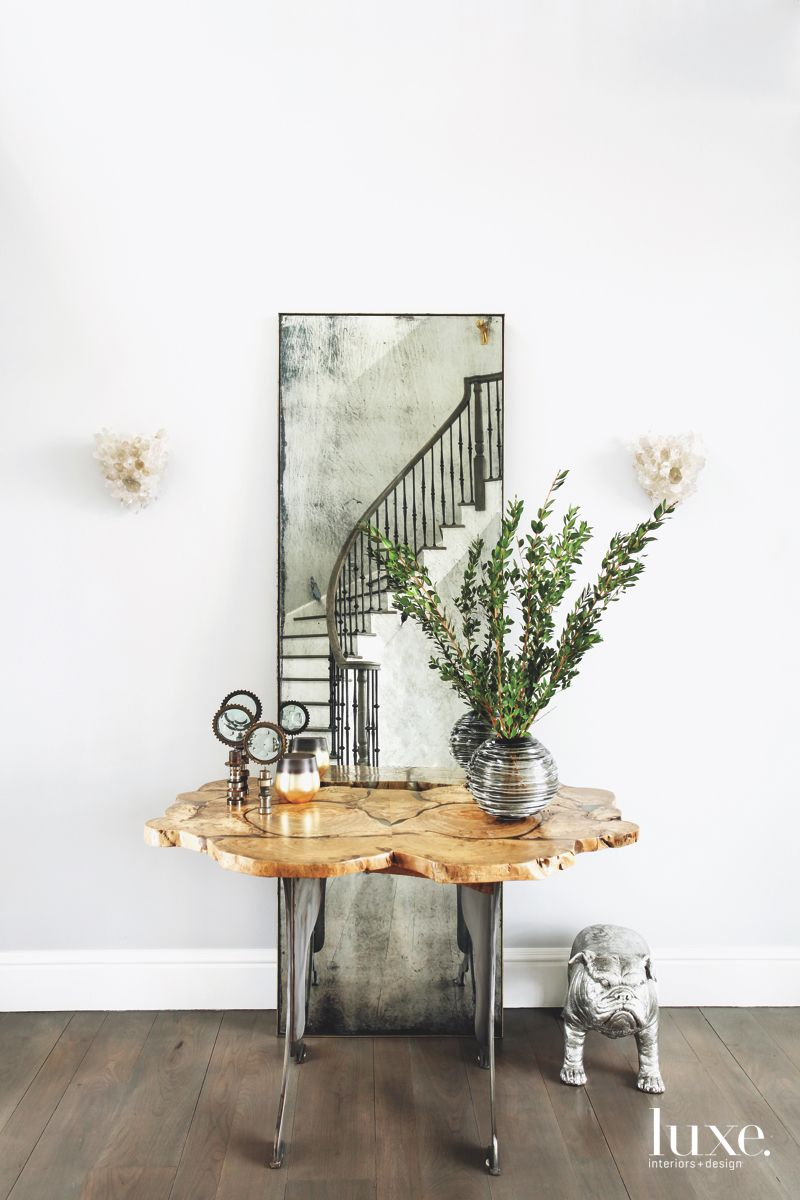 Antique Mirror and Dog Entryway with Sculpture, Plant and Sconces
