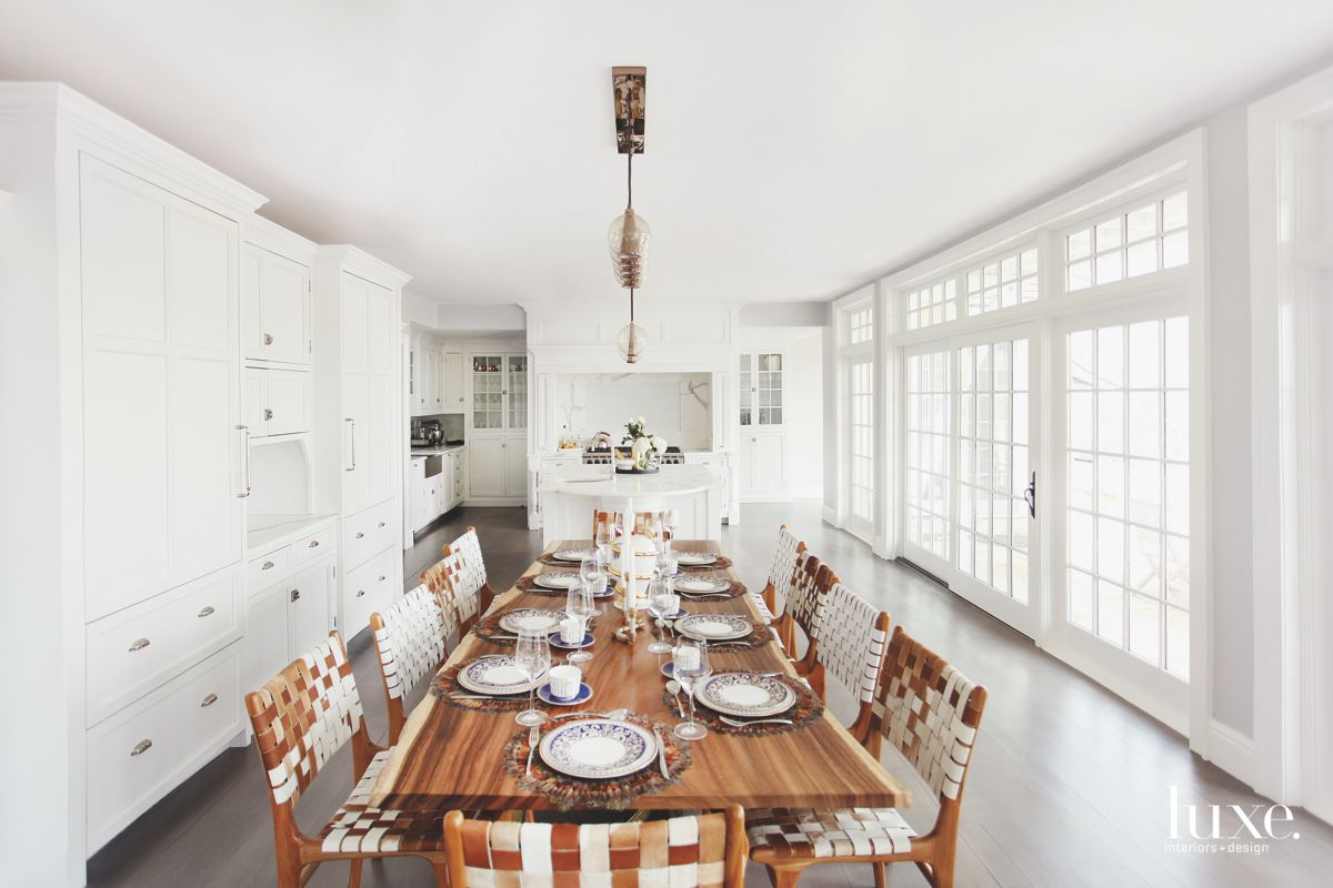 Wooden Dining Table Dining Room with White Cabinetry and Open Flow Kitchen