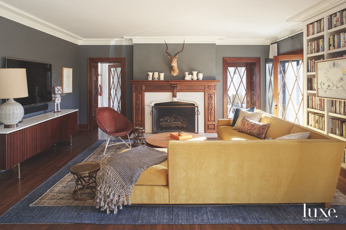 Antelope Dark Living Room with Yellow Sofa Television and Fireplace with Shelving