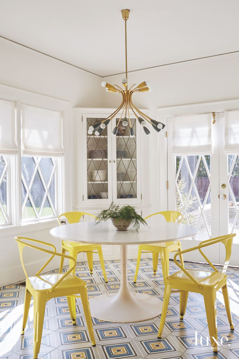 Yellow Metal Chair Breakfast Room with Geometric Tile and Whimsical Lighting and Dish Storage