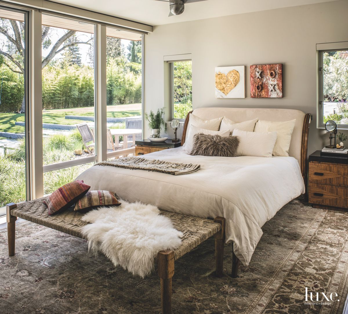 Antique Rug Master Bedroom with Fluffy Pillows and Throw with Artwork