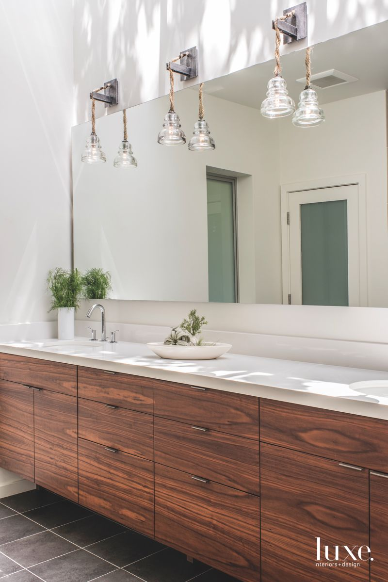 Walnut Cabinetry Master Bathroom with Pendant Lighting with Miniature Plants