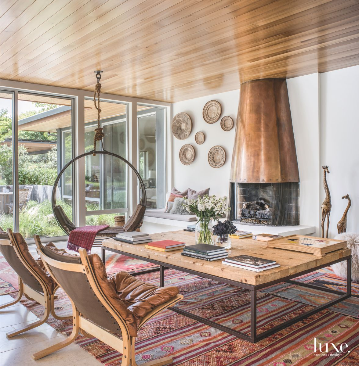 Copper Fireplace with Circular Swing Chair and Vibrant Turkish Rug