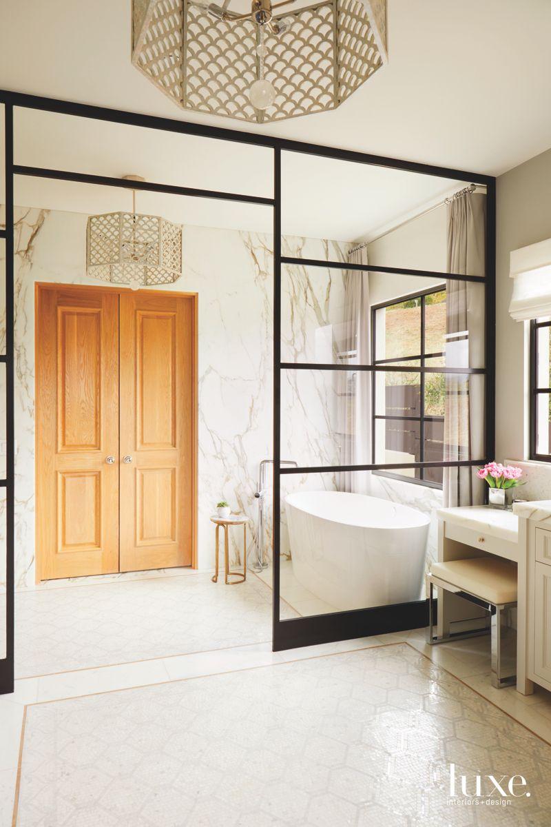 Gold Door Marble Bathroom With Gold Scallop Lighting