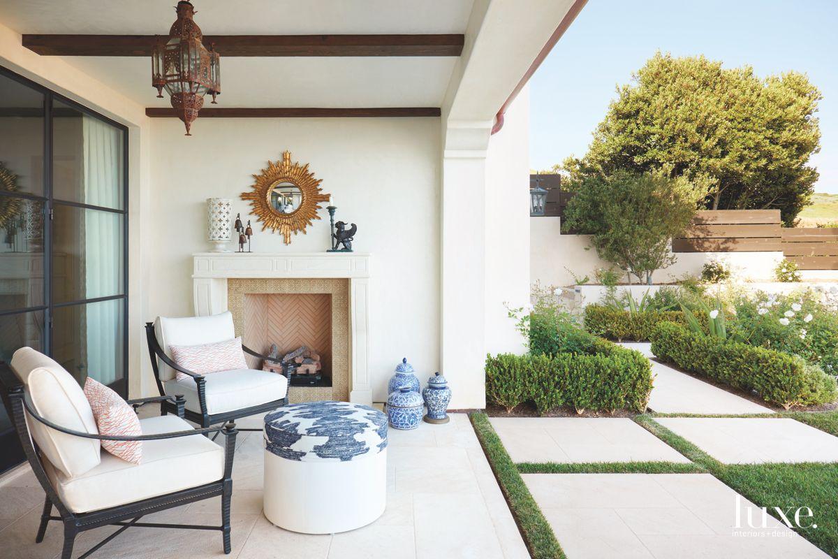 Herringbone Outdoor Fireplace with Twin Seating, and Lantern Lighting