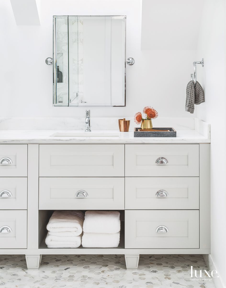 All White and Chrome Accented Master Bathroom with Square Mirror