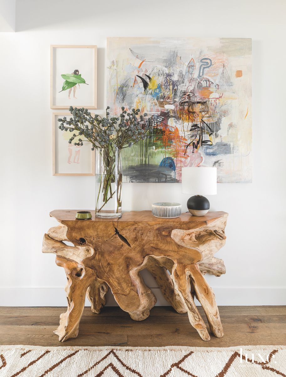 Natural Wooden Table Entryway with Abstract Art and Rug