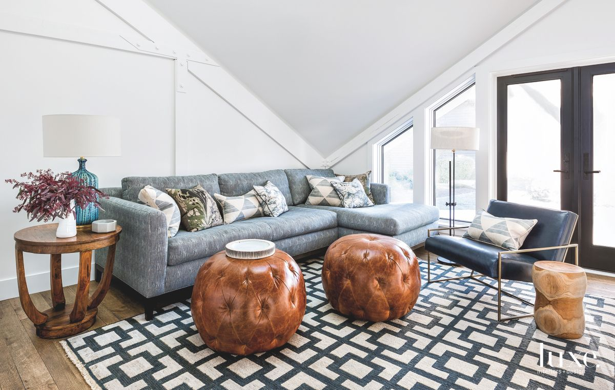 Geometric Patterned Rug TV Room with Leather Ottomans