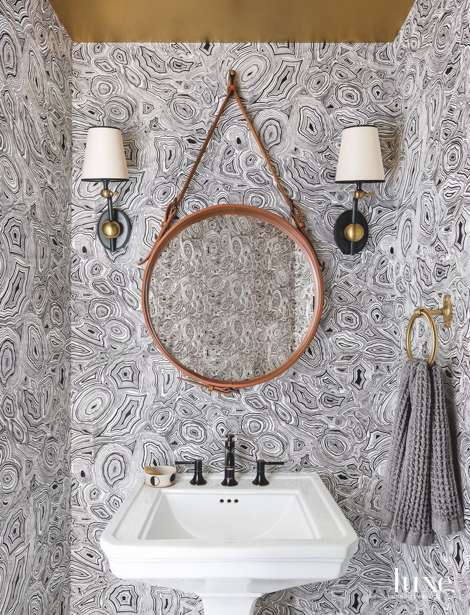 Organic Patterned Black and White Wallpaper Powder Room with Circular Mirror
