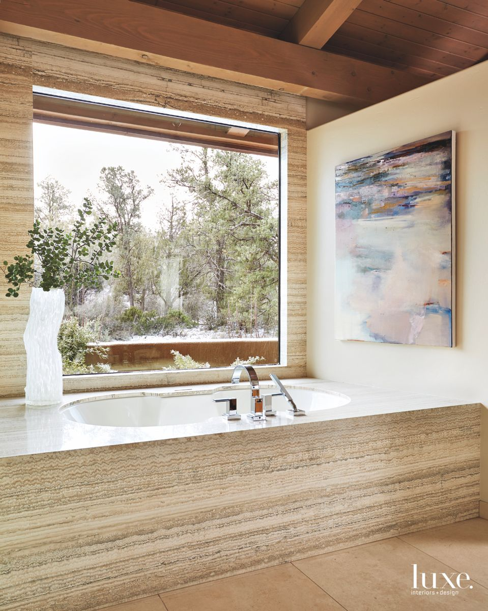 Sand Colored Master Bathroom with Open Window and Abstract Art