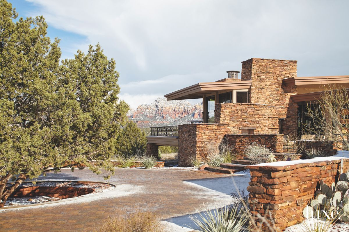 Sandstone Exterior Home with Circular Driveway