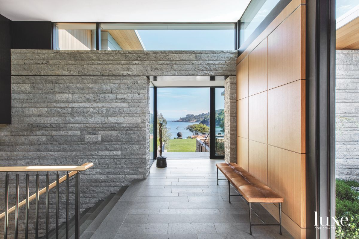 Modernist Tiburon Home Entryway with Wooden Panel Wall and Stone