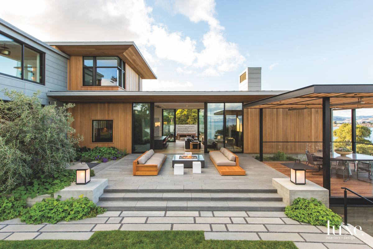San Francisco Bay Home Exterior with Outdoor Furniture, Stonework, and Siding