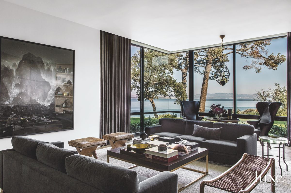 Corner Window Living Room with Artwork and Sofas