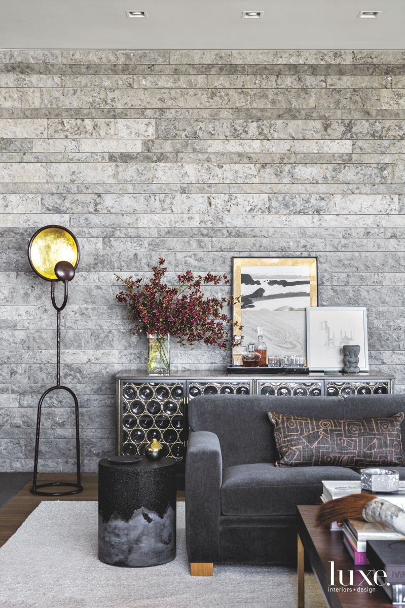 Limestone Wall with Wine Rack and Sofa Room