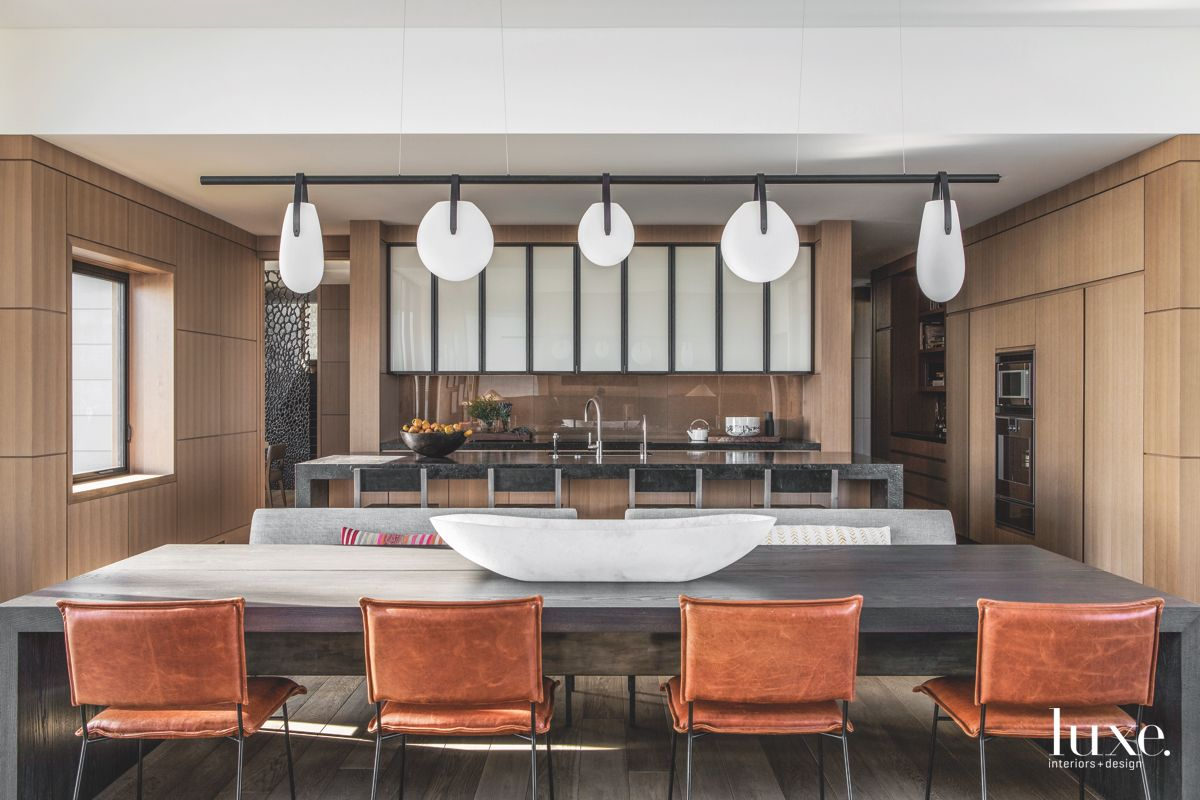 Open Kitchen Dining Room with Dangling Pendants and Burnt Orange Chairs