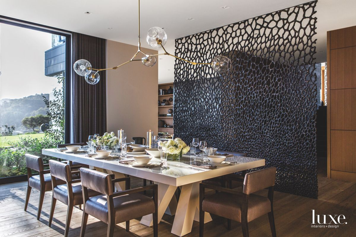 Formal Dining Room with Custom Black Screen and Chandelier