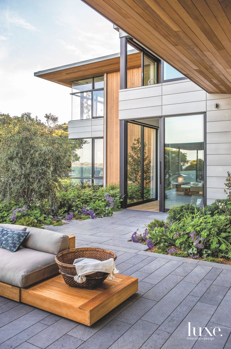 Steel and Wood Siding Exterior with Outdoor Furniture
