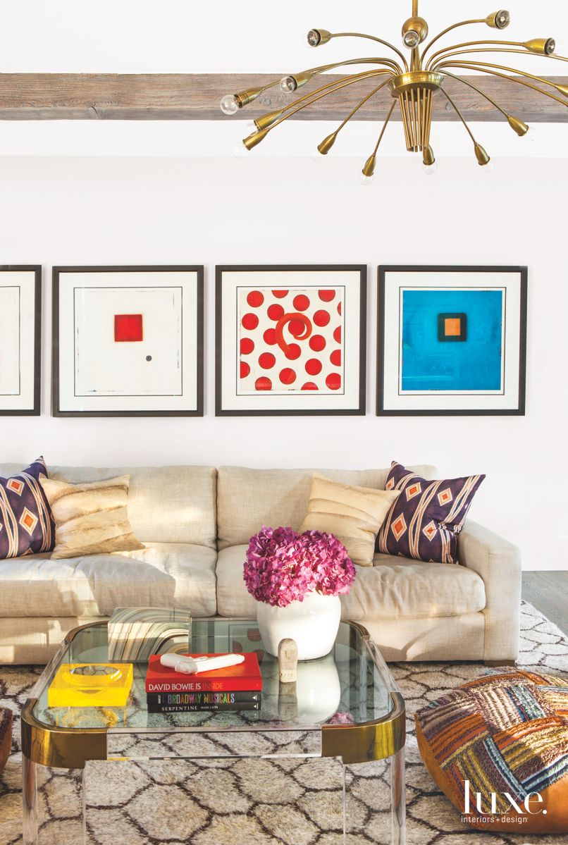 A Blended Family Room with Chandelier and Colorful Art Pieces