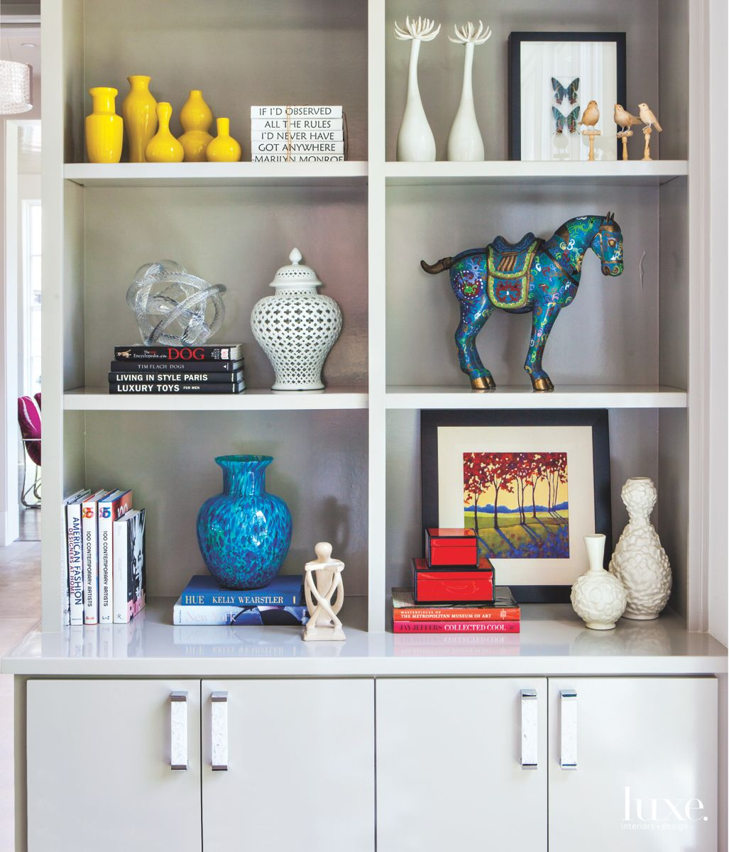Cabinets with Eclectic Art, Horse, Vase, and Other Pieces