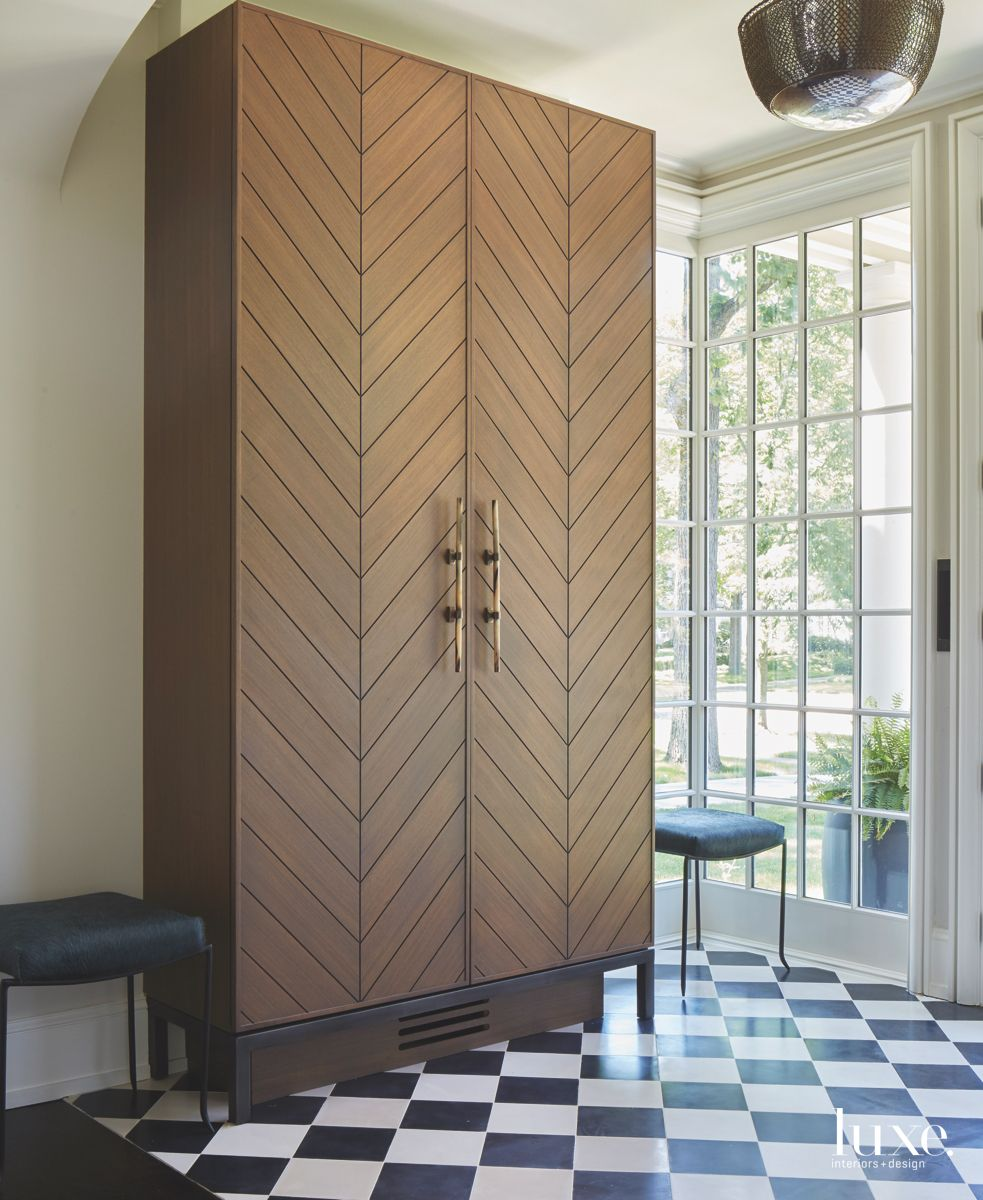 Checker Floor and Chevron Cabinet Foyer with Twin Stools