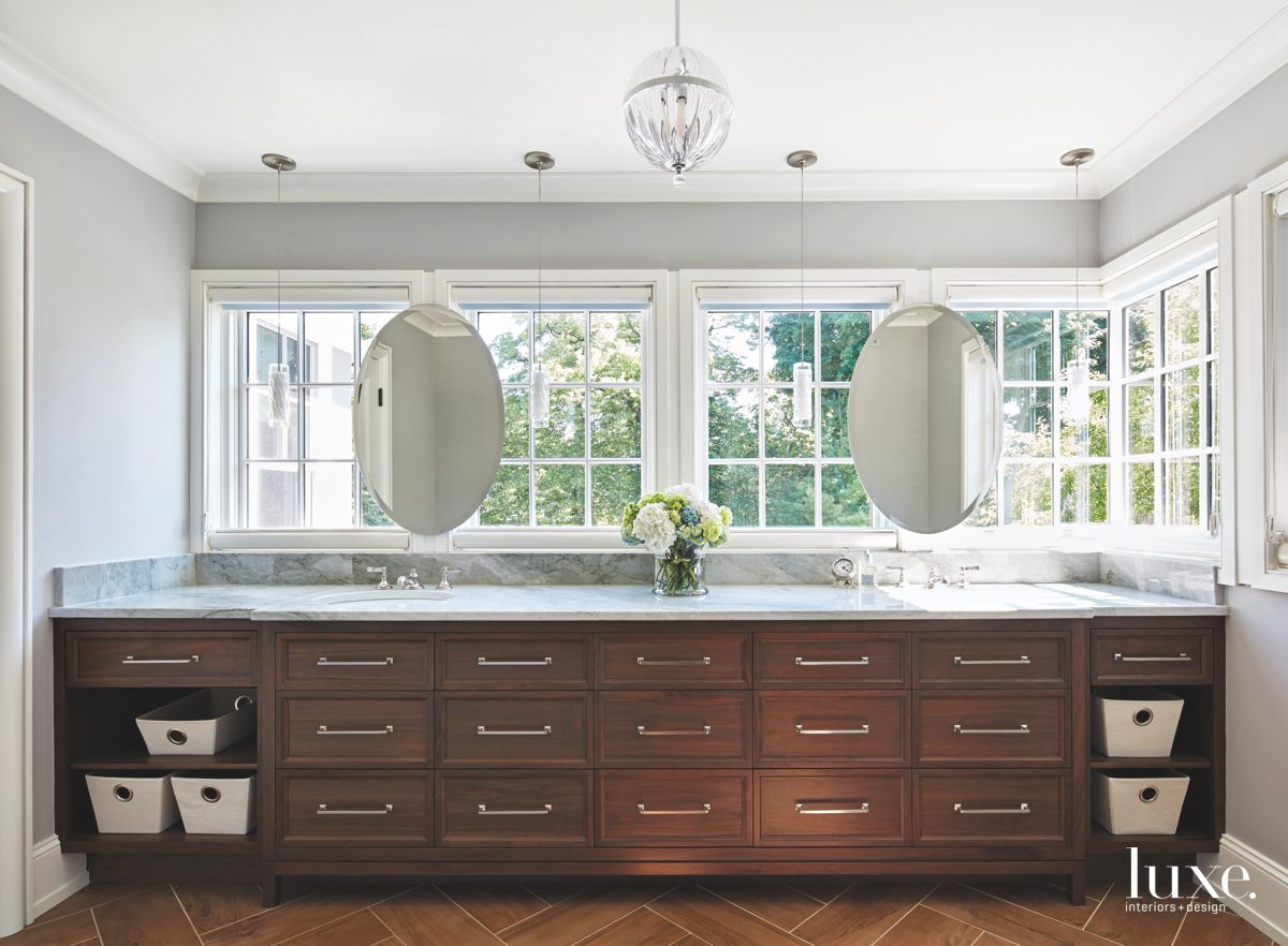 Double Mirror Master Bathroom with Dark Cabinet Storage