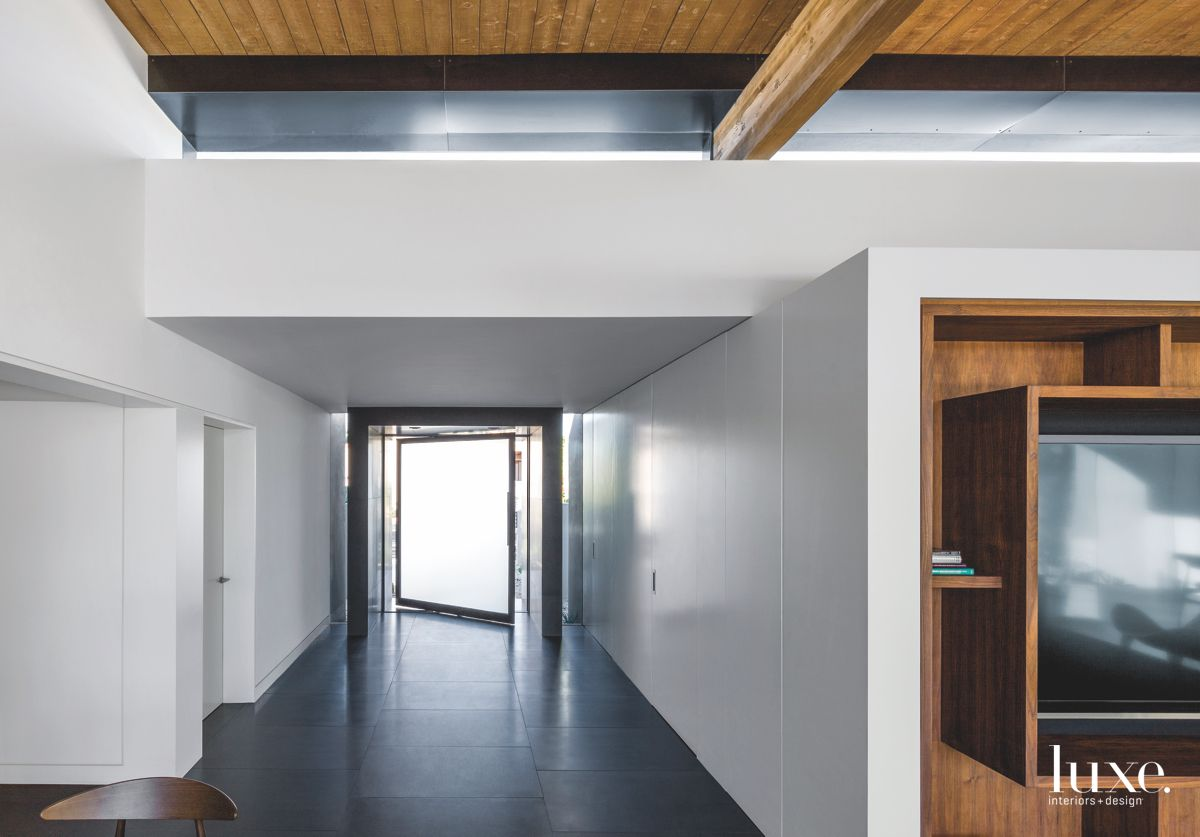 Clerestory Window Entry with Pivoting Door and Black Flooring