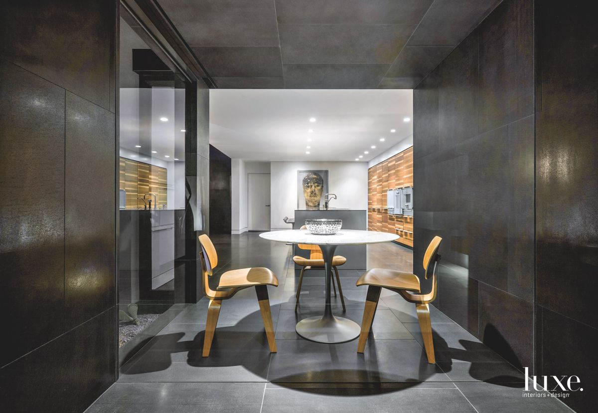 Black Basalt Eating Area with Circular Table and Eames Chairs