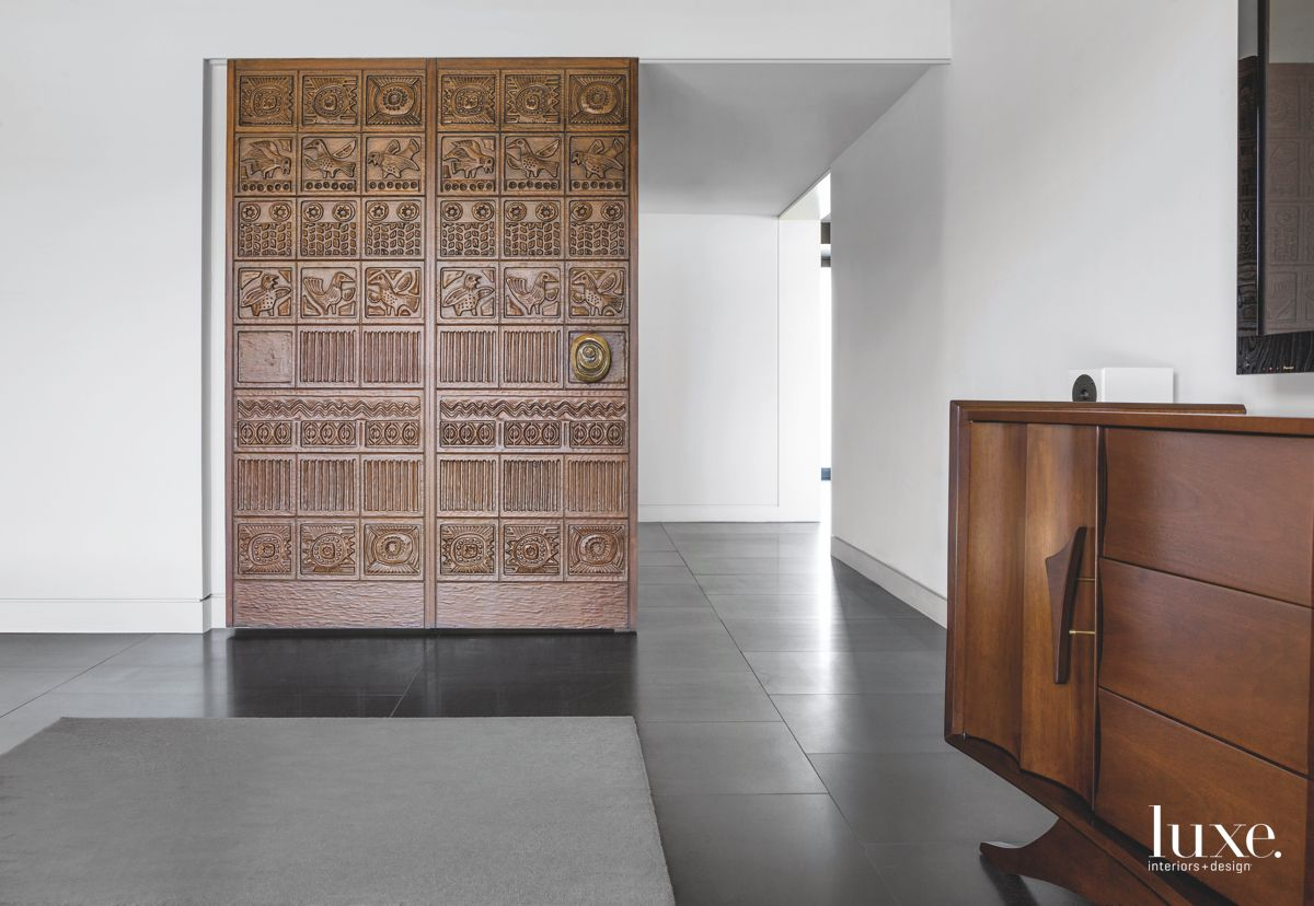Sliding Carved Adobe Wood Doors in Gray Contemporary Home