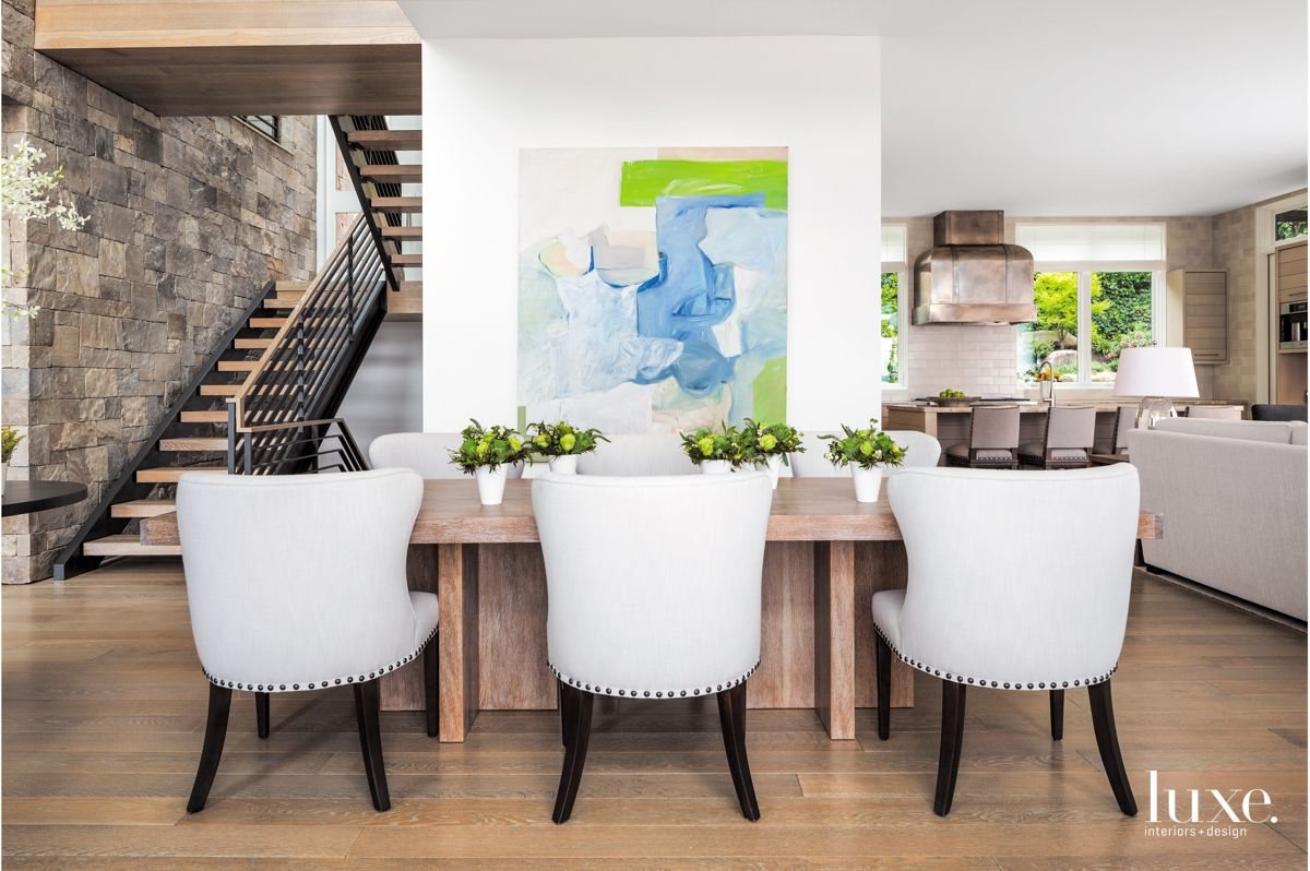 Dining Area with Modern Art and Staircase
