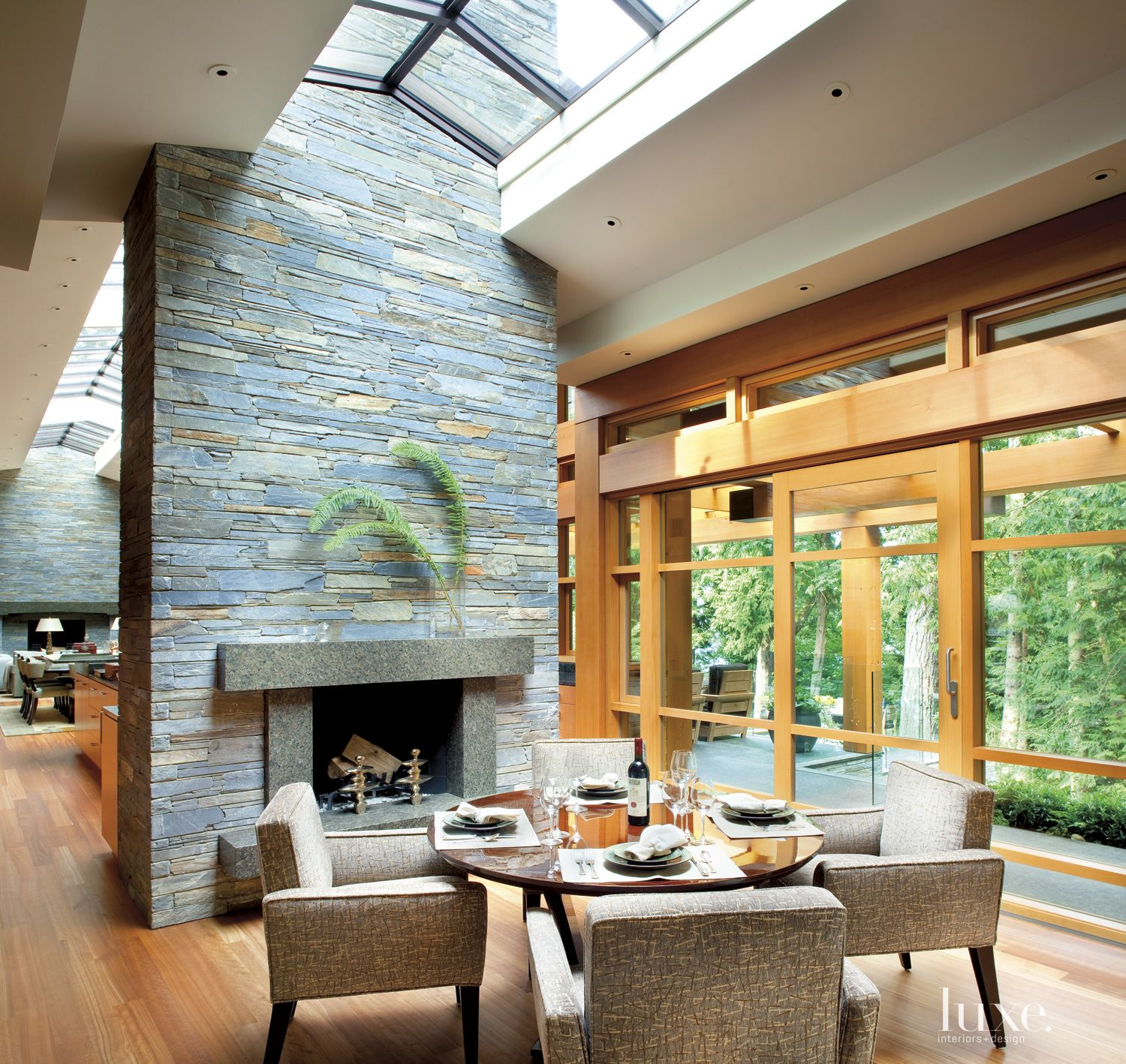 Contemporary Neutral Breakfast Area with Stacked Stone Fireplace