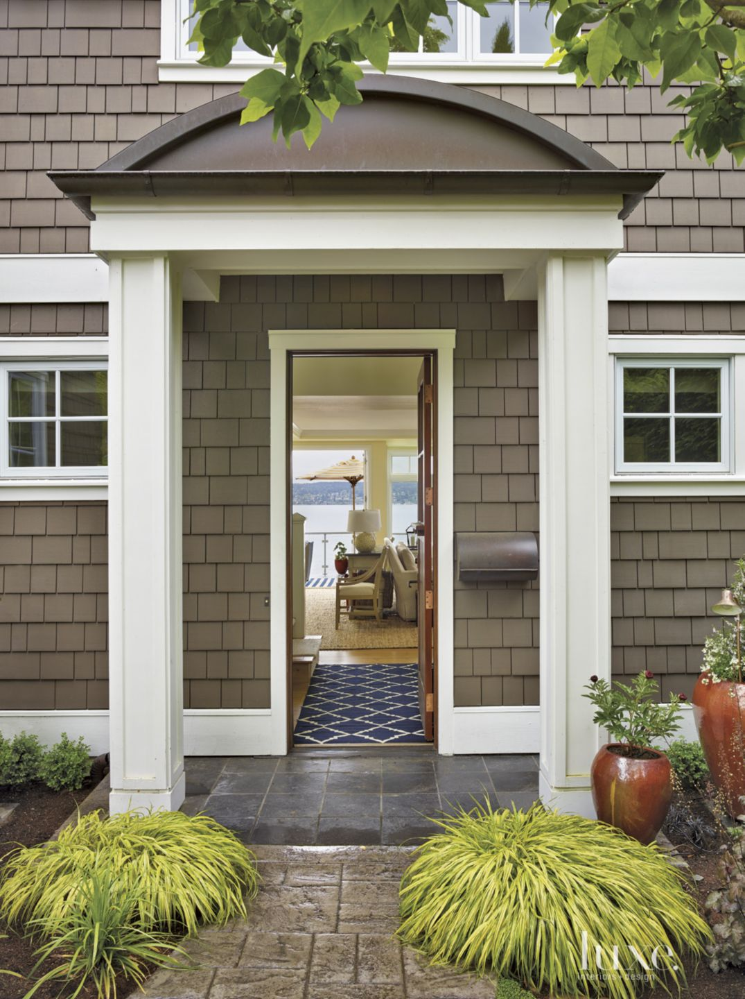 Contemporary Brown Entry with Stone Pavers