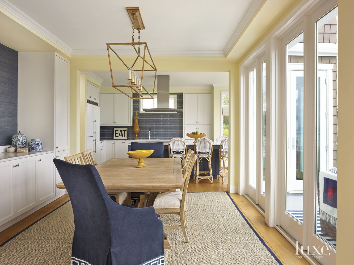 Contemporary Yellow Dining Area with Slipcovered Chairs