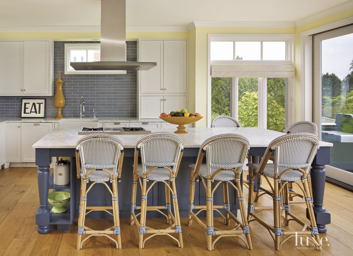 Contemporary Yellow Kitchen with Wicker Stools