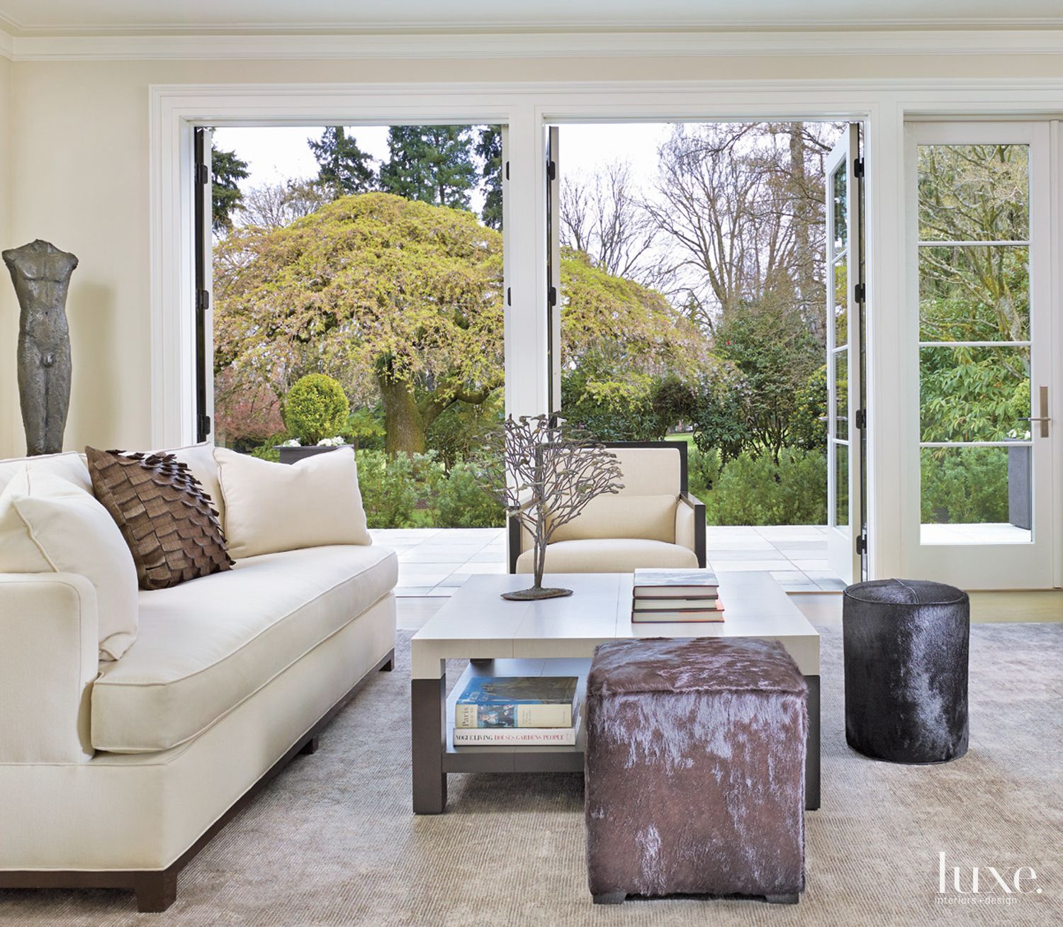 Contemporary White Living Room with Hair-On-Hide Ottomans