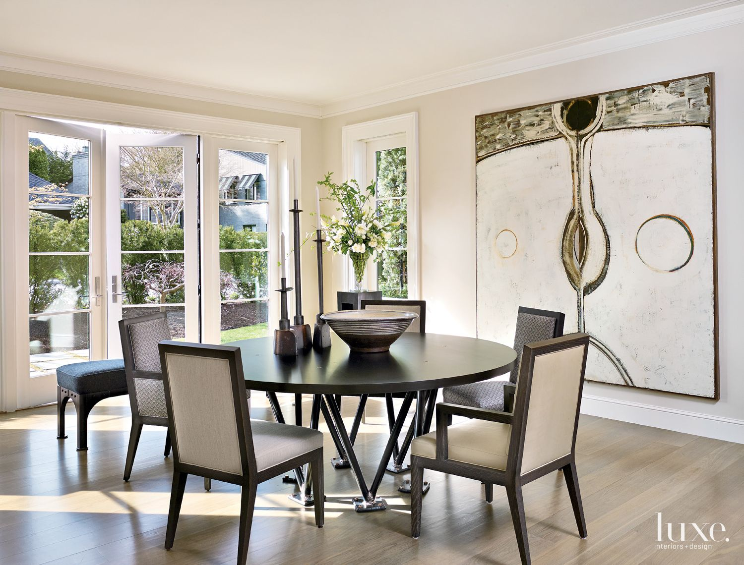 Contemporary White Dining Room with French Windows
