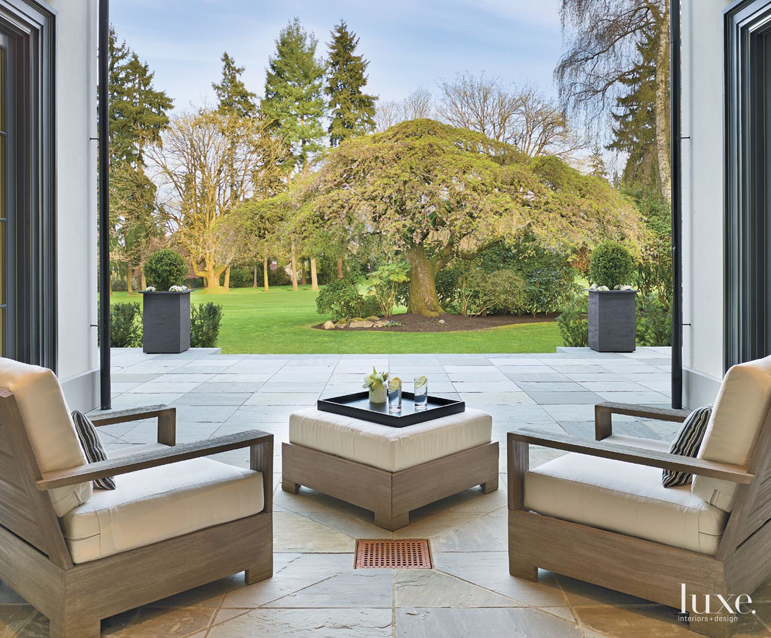 Contemporary Covered Patio with Sandstone Pavers