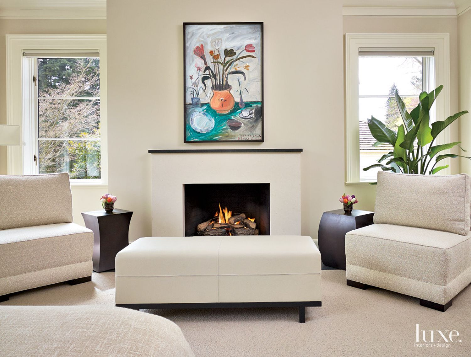 Contemporary White Bedroom Sitting Area with Fireplace