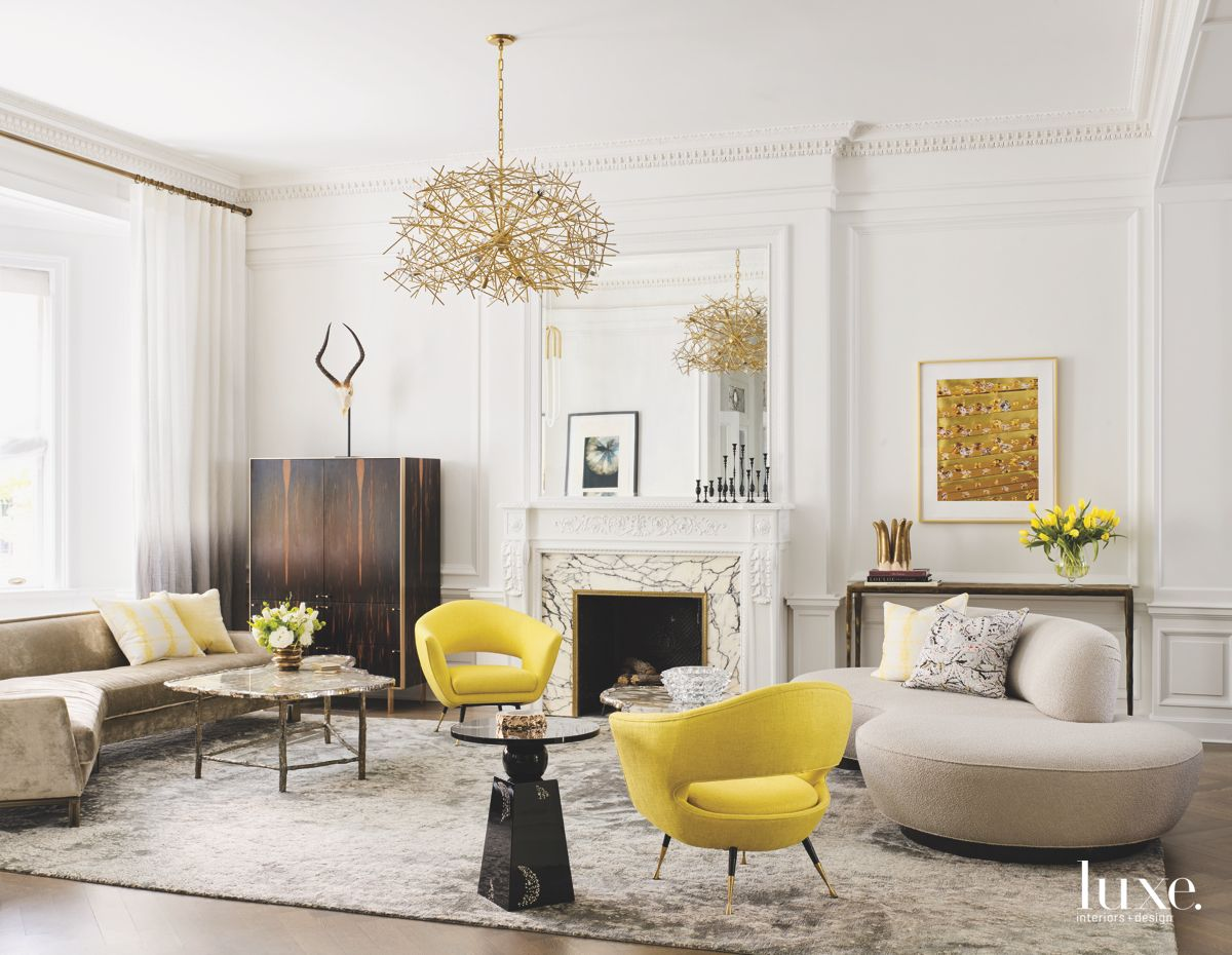 Formal Living Room With Yellow Chairs, Marble Fireplace, Ornate Mantle Chandelier and Rug
