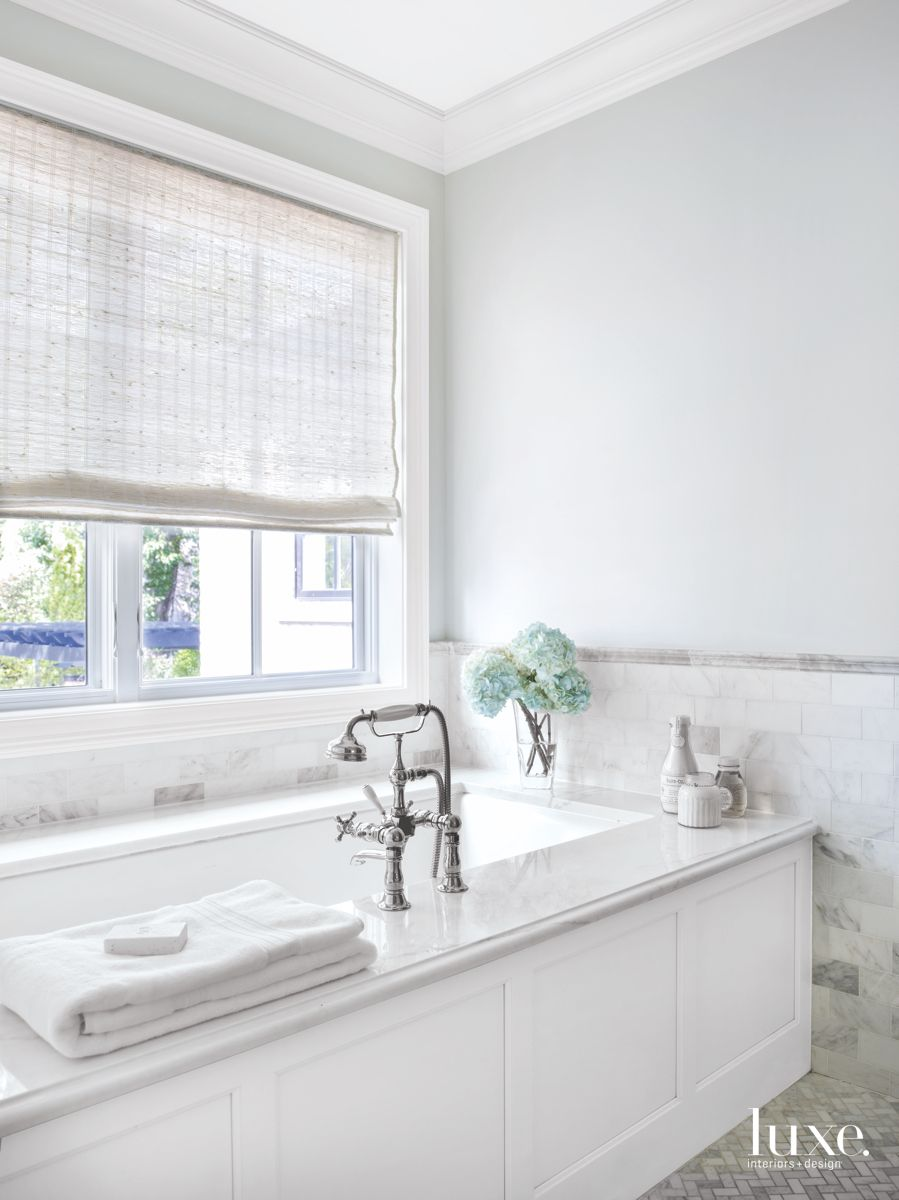 Traditionally Designed White Bathroom with Sophisticated Details and Finishes