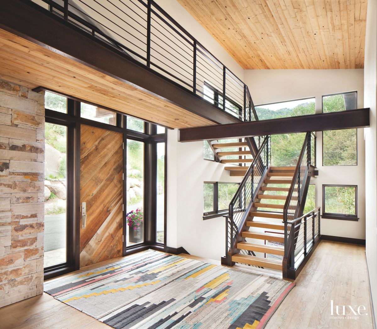 Reclaimed Wood Door Entrance with Contemporary Staircase and Windows