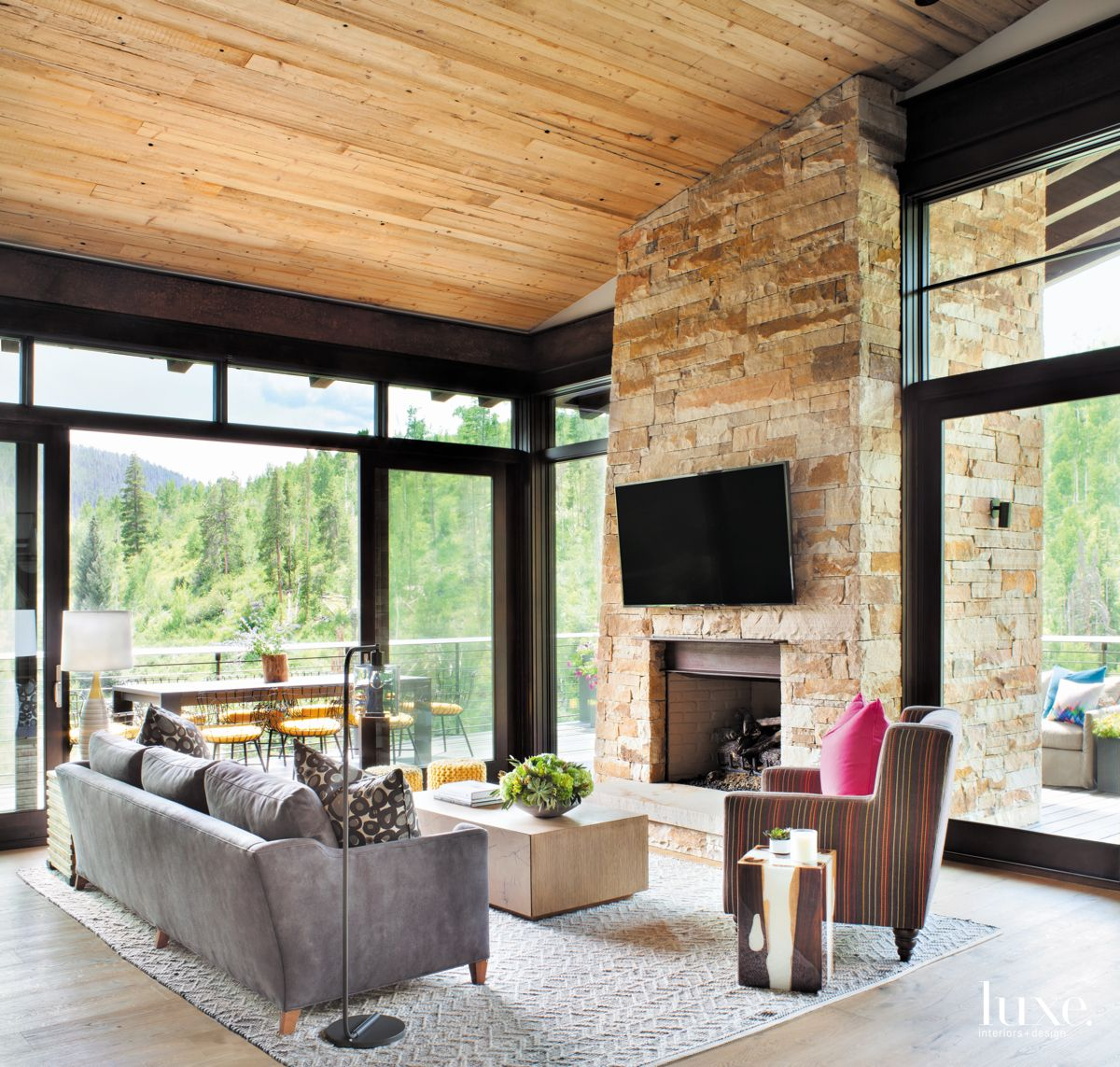 Television Mounted on a Stone Fireplace Living Room with Panoramic Views