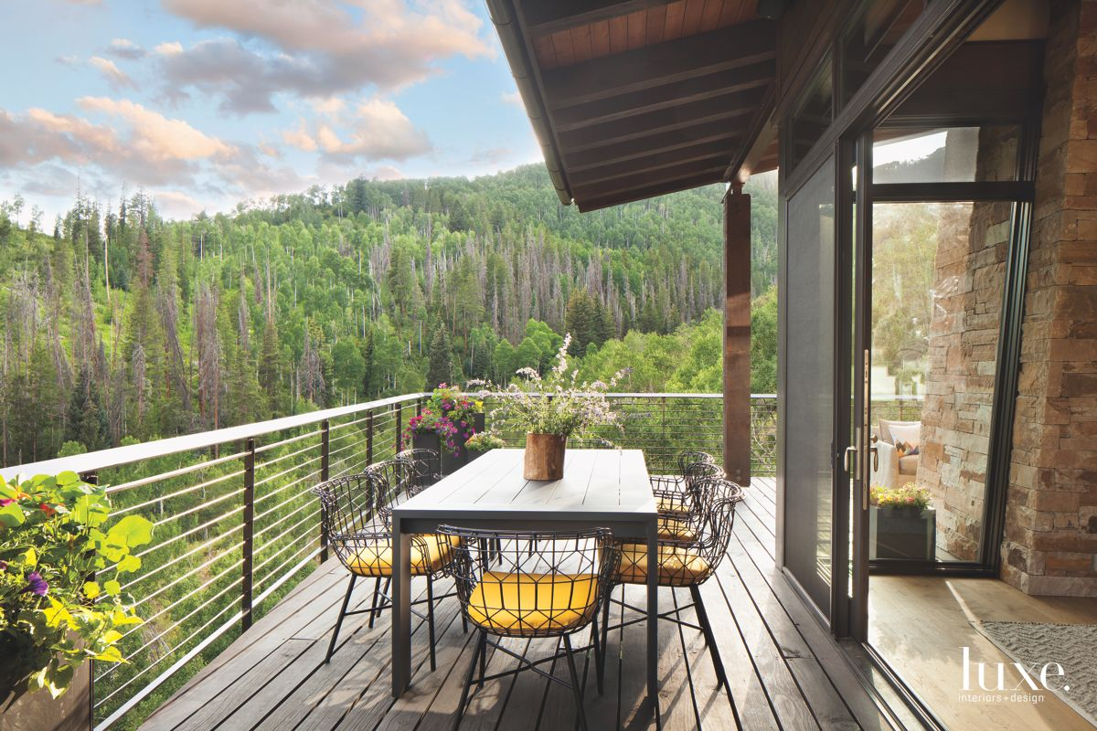 Geometric Chair Outdoor Patio with Plants and Mountain Surround