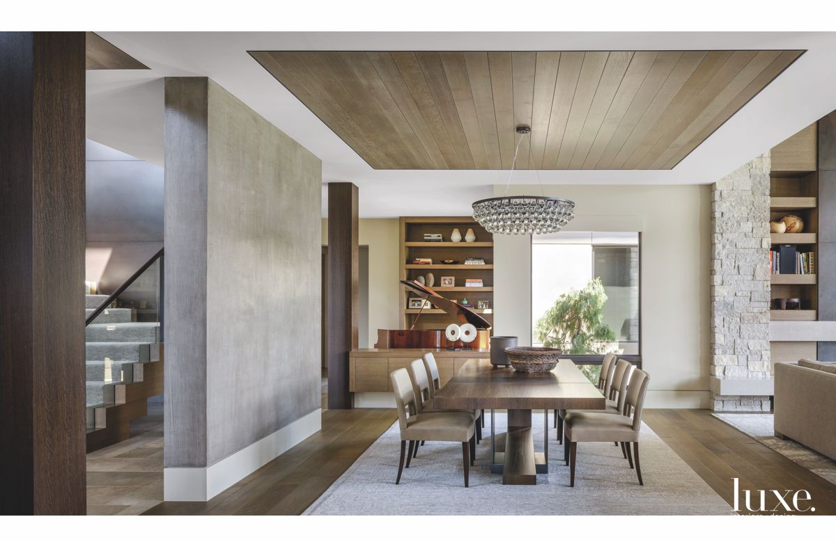 Grayscale Dining Room with Wooden Ceiling and Chandelier