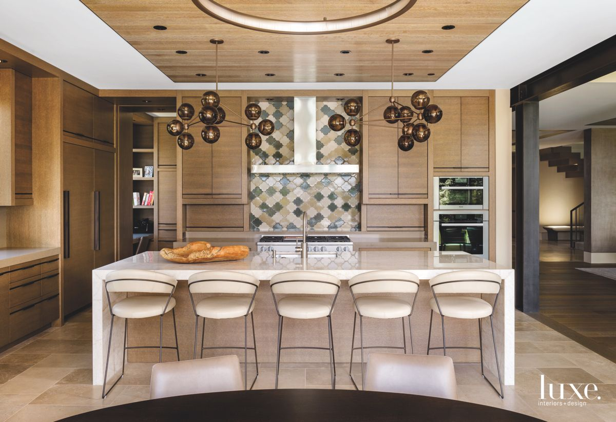 Cosmic Kitchen with Spherical Chandeliers, Backsplash, and Barstools