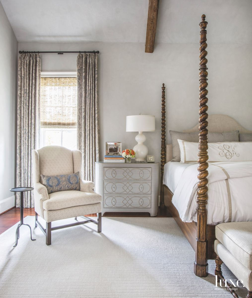 Four Poster Bed White and Gray Master Bedroom with Seat and Side Table