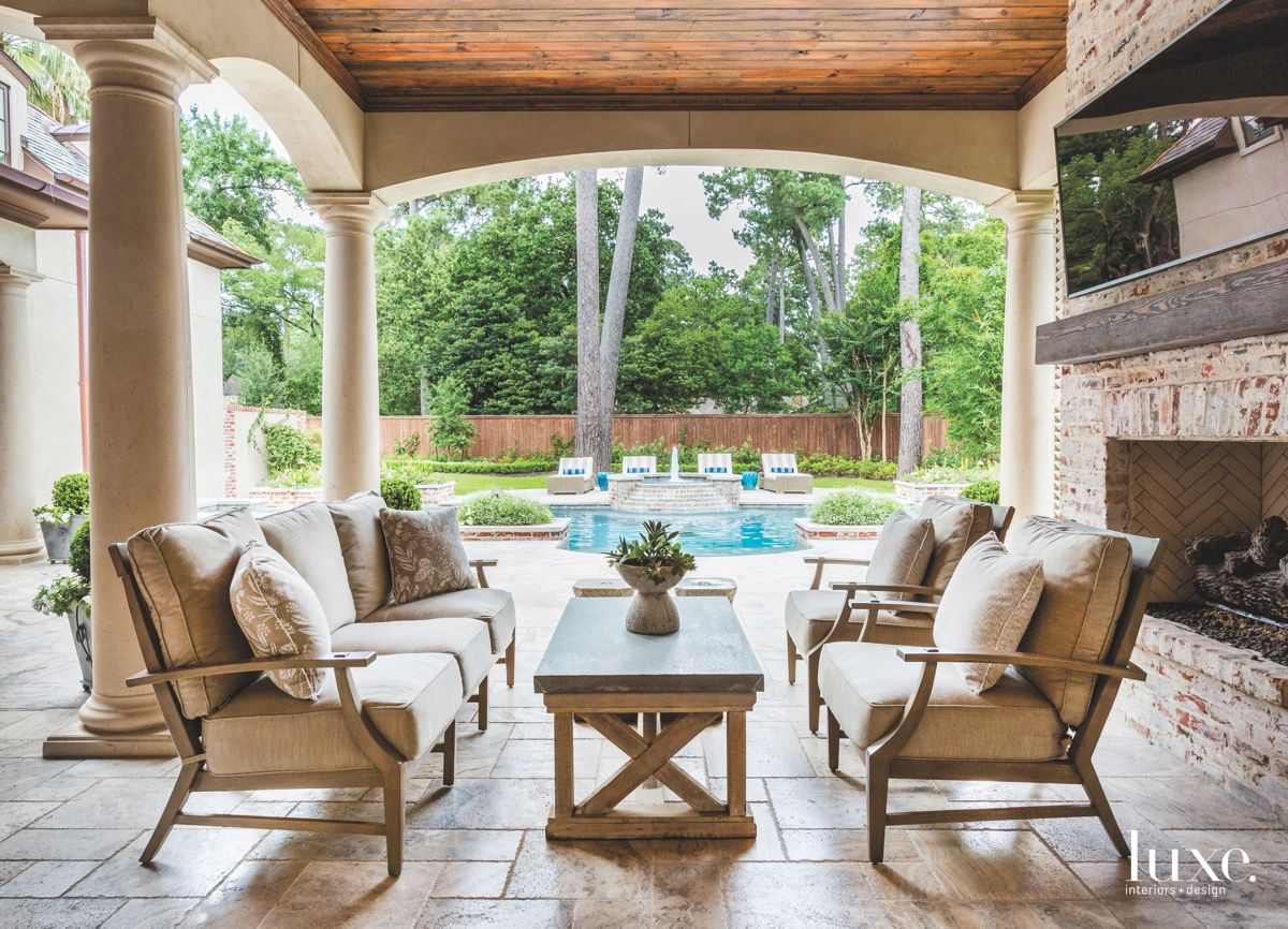 Pool View Exposed Brick Covered Patio with Fireplace, Television and Comfy Seating